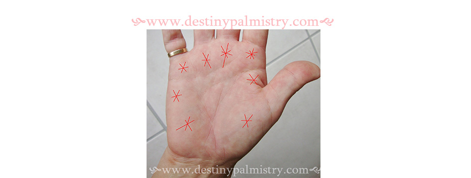 star marks on the palm