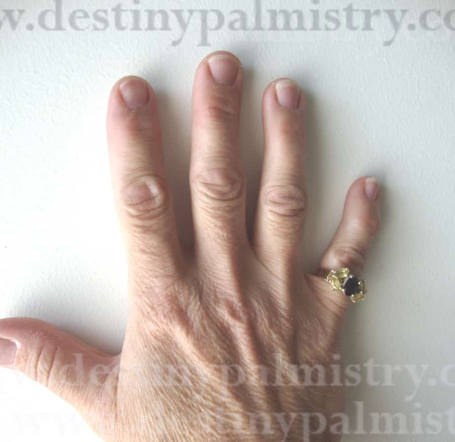 manly hands on a woman, palmistry lessons, bent middle finger
