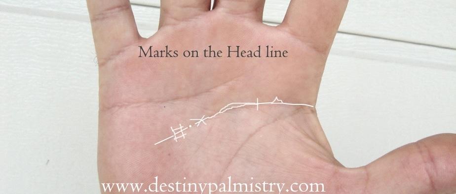 markings on the head line, cross on head line, island on head line, chained head line